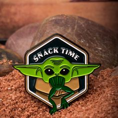 It's everyone's favorite time - snack time! This enamel pin features The Mandalorian's adorable Yoda-like character, The Child. Even better, he's enjoying some yummy frog. You know you want one - and is the place to get it! Star Wars Jewelry, Fandom Jewelry, Disney Plus, Mandalorian, Jewelry Branding, Baby Kids, Lapel Pins, Stars, Enamel