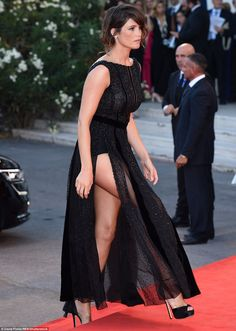 Flashing the flesh: The thigh's clearly the limit for Gemma, who's dress showed off her sh...