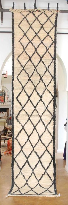 "This Beni Ourain Moroccan carpet runner will add just the right dose of  Moroccan design to your hallway.  All wool and handknotted. Black and  beige.  Black + white  |  35"" x 154""  