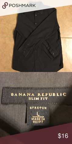 Men's Banana Republic Button Down Dress Shirt L Men's Banana Republic Button Down Shirt. Large. Slim fit, stretch.  Gorgeous charcoal gray solid color.  Worn once or twice, like new!  Smoke free home, bundle and save! Banana Republic Shirts Casual Button Down Shirts