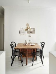 Wood table black chairs kitchen