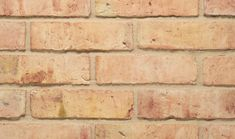 The Oxford Yellow Multi Waterstruck. A high quality handmade pale brick with pink and orange tones which has a relatively smooth finish. This particular brick is commonly found across Oxfordshire, Cambridgeshire, East Coast and East Anglia. This waterstruck brick has a unique texture due to the clay mix, as well as the water used as a releasing agent for the moulding process, giving the brick a relatively smooth appearance.