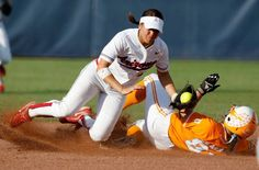 University of Tennessee's Raven Chavanne makes it to second ase under Arizona's Kristen Arriola in the first inning of the Women's College World Series game between Tennessee and Arizona at ASA Hall of Fame Stadium in Oklahoma City, Thursday, June 3, 2010. Photo by Bryan Terry, The Oklahoman