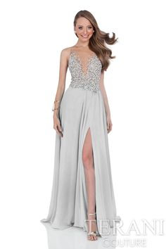 A-line prom gown with crystal encrusted nude illusion bodice. This prom dress is finished with a flowing chiffon skirt with thigh high slit at the left leg.