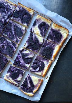 Easy Keto Blueberry Cheesecake Bars on black background