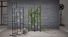 Display of plant stands with galvanized plant pots