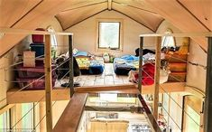 A tiny house on wheels built for a family of four with high-quality components in durango, colorado. the see-through walkway between the kids' loft and Tiny House Kits, Tiny House Loft, Tiny House Swoon, Building A Tiny House, Tiny House Living, Tiny House Plans, Tiny House Design, Tiny House On Wheels, Tiny House Family