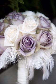 Bouquet of Purple & white roses with white  feathers