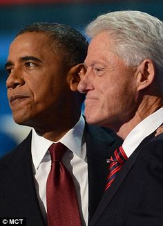 President Barack Obama walks on stage during day Two of the Democratic National Convention last night to embrace former president Bill Clinton