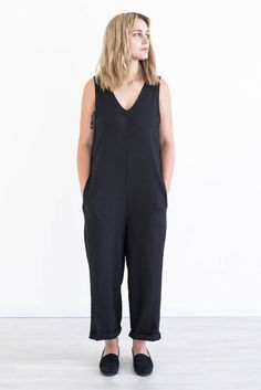 Pull on jumpsuit with v-neckline and inseam pockets. Loose fit through the hips and legs. Lower back v-neckline and armholes are slightly lower to allow for easy on and off. Linen Rayon blend. Made in