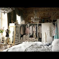 vintage french boutique - I love the stacked boxes, the pale colours, the chandelier and the big mirror.