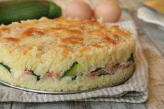Torta di riso con formaggio, zucchine e prosciutto cotto