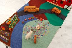 Wool Waldorf Spring Farm Playmat, Meadow, River and Garden. $65,00, via Etsy.