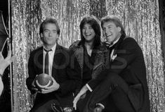 """Photo: Huey Lewis, Steve Perry and Dwight Clark pose for a photo at the 1985 """"Bammies"""", the Bay Area Music Awards, hosted every year since 1977 by BAM, a San Francisco music magazine. Clark, a San Francisco 49er, presented the Outstanding Group award to Huey Lewis and the News, and Perry won Outstanding Album and Outstanding Male Vocalist. March 23, 1985 San Francisco, California, USA"""
