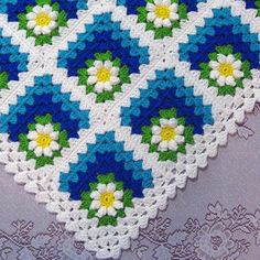 Mitered Summer Daisy Baby AfghanThis crochet diagram is available for free... Free Download: Mitered Summer Daisy Afghan