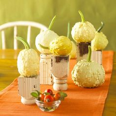 Bring your pumpkins to a whole new level with mini pedestals for a fun, fall centerpiece: http://www.bhg.com/decorating/seasonal/fall/pretty-pumpkins-for-fall/?socsrc=bhgpin092714prettypumpkinsforfall&page=22