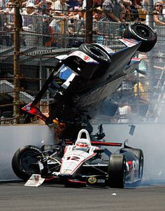 Mike Conway crashes hard into the catch fence after being unsafely released from the pits by his team