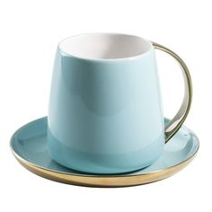 Enjoy your favorite tea in this lovely porcelain mug and saucer, showcasing a stone-hued finish and gold-toned trim.. Light Blue. Teacup - Cup and Saucer - Coffee Cup