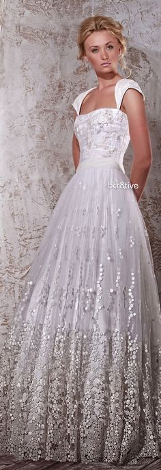 I do not normally pin bridal  gowns  but this was so lovely that I could not resist.
