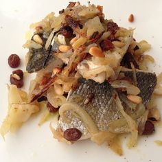 Seabass alla Palermitana - Grilled seabass with onions, pine nuts and golden sultanas.