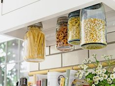 Ditch the cardboard boxes and plastic bags that go with your cereal, snacks and dry goods. They're ugly, take up lots of space and don't keep your food fresh. Instead, opt for glass jars (like HGTV Magazine did here) or airtight food storage containers.