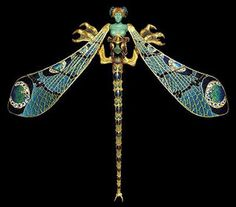 Dragonfly woman corsage ornament (1897–1898). Gold, enamel, chrysoprase, moonstones, and diamonds. R. Lalique combined enameling with precious stones and gold and by this he initiated a revolution in French jewellery design by asserting that his work should be valued for its design and craftsmanship, rather than for the value of the materials used.
