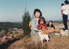 When I was young. With mom on the family grave mountain. I am holding a tiger doll.