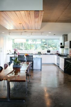 Lots of windows and concrete floors. Leah + Matt house tour on Apartment Therapy.