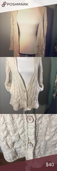 {Free people} comfy cream cardigan sweater A Cardigan Sweater for Women. Infuse a little comfort and luxury into your current sweater collection with a new cardigan. Throw a cardigan over a shorter mini dress, tights, and your favorite pair of ankle boots. Textured cable knit and raglan sleeves lend a traditional touch to this long, cozy Free People cardigan. Welt side pockets and wooden buttons.  💥missing top button💥.      #8 Free People Sweaters Cardigans