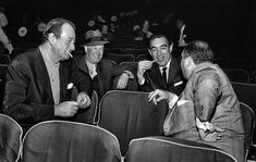 John Wayne, Maurice Chevalier and Anthony Quinn