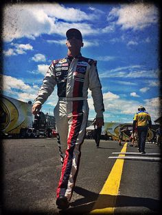 Kevin Harvick heads to his car before the start of Sprint Cup practice at…