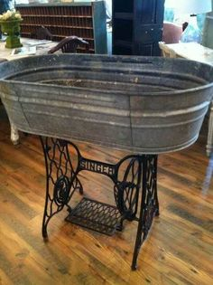 Vintage Sewing Wash Tub and Sewing Machine Base Create Magic - Reused and repurposed galvanized tub and bucket ideas will give your space a rustic feature that you will be proud of. Find the best designs! Sewing Machine Tables, Treadle Sewing Machines, Antique Sewing Machines, Sewing Tables, Furniture Makeover, Diy Furniture, Outdoor Furniture, Outdoor Decor, Furniture Stores