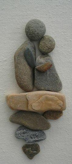 dekoration mit steinen - zwei menschen figuren