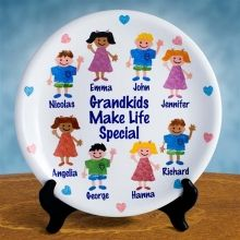 Personalized Porcelain Grandkids Make Life Special Keepsake Plates. Grandparents Love It! Cherish your grandkids forever with our personalized Grandparents Plate. Each plate can be decorated with up to six grandkids and two Grandparents. This porcelain plate makes an extra special gift for any grandparent. The plate is shipped with a FREE plate stand. This piece is sure to become a treasured family heirloom.