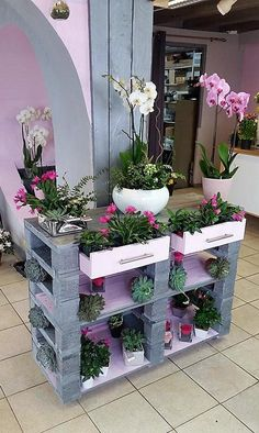 No one can get a planter like this one from the market and we are sure due to which we have added this repurposed wood pallet planter in this list of awesome pallet items. The upper layer contains drawer type space to place the plants and it is painted white to make it look prominent.