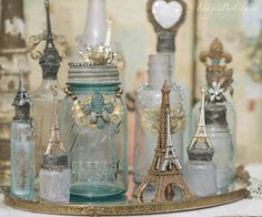 Love this idea! Glue your favorite trinkets onto bottles and mason jars.