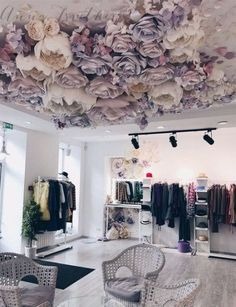 This Paper flower ceiling is very off setting making it seem as though the room may be upside down. Paper flower ceiling but twinkly lights instead Absolutely love the way my amazing client set up the flowers I made for her beauty studio!