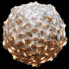Light shade made from playing cards.