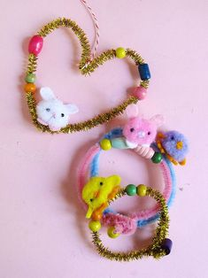 How To Make Sweet DIY Spring Bracelets With Pom Poms for the entire class. Great student project!
