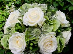 Avalanche+ by Meijer Roses styled in a bridal bouquet with a white and green colored theme! (photo by LM Flower Fashion)