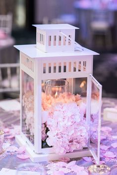 White lantern centrepiece with blush and white flowers and pillar candle. Romantic blush, white, silver and grey head table and cake table wedding inspiration. Design by Whim Event Planning and Design - Toronto Wedding Planners. White on white blush wedding cake. Cherry blossoms, white on blush wedding backdrop. Romantic wedding inspiration. Modern Wedding Inspiration. 2017 Wedding trends. 2018 wedding trends. Photo by Photography by Emma H. www.eventsbywhim.c