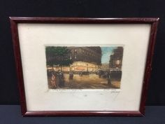 ANTIQUE COLORED ETCHING OF A STREET SCENE IN PARIS TITLED LA PLACE DE L'OPERA ET LA CAFE DE LA PAIX. SIGNED IN PENCIL IN THE LOWER RIGHT, HUBERT, CIRCA 1920S. JUST ABOVE THAT IT READS EAU-FORTE ORIGINALE (ORIGINAL ETCHING). SET BEHIND GLASS, THE FRAME MEASURES 6.5 X 8.5 INCHES.