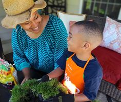 Gardening is good for the soul... and the family. That's Erika Ward of BluLabel Bungalow and her son sharing the fun of gardening. They worked together to spruce up their back patio with new plants and flowers. See it on The Home Depot Blog. || @mrserikaward