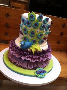 Birthday cake for 11 year old girl who loves peacocks. Not as sophisticated as many of the gorgeous peacock cakes I've seen on CC. Tr...