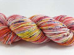 """Hand Dyed Speckled Yarn Pink Yellow SW Merino handdyed, """"Speckled Pink"""" colorway by Spoiled Greyhounds (affiliate link)"""