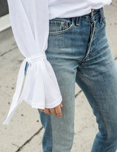 Statement bell sleeves and vintage wash jeans make for a perfect pairing