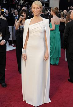 Cape dresses have been making a splash lately, thanks to the celebrities who have been embracing this chic trend in the past few years. Gwyneth Paltrow stunned at the 2012 Oscars in a white Tom Ford cape dress; Gwyneth Paltrow, Vestido Tom Ford, Glamour, Oscar 2012, Best Oscar Dresses, Vestidos Oscar, Tom Ford Dress, Nice Dresses, Formal Dresses