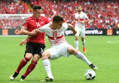 Switzerland's midfielder Granit Xhaka (R) challenges his brother Albania's midfielder Taulant Xhaka (L) during the Euro 2016 group A football match between Albania and Switzerland the Bollaert-Delelis Stadium in Lens on June 11, 2016. / AFP / FRANCOIS LO PRESTI