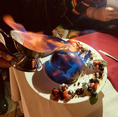 Flaming dessert at at You are in for a treat full of dark and topped with flaming with this delectable California Restaurants, Cabo, Chocolate Fondue, Strawberries, Espresso, Treats, Desserts, Food, Espresso Coffee