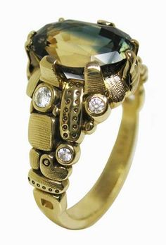 This beauty just recently went to it's forever home. This Alex Sepkus piece features an unusual bi-color sapphire, with green and yellow hues, accented with white diamonds.